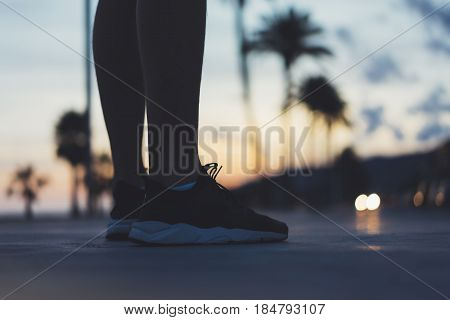 Male feet with sneakers close up on background sunset or sunrise nature outdoor sports man running marathon workout style person fitness foot do steps healthy lifestyle on relax view