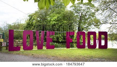 MAPLEDURHAM UK - MAY 1 2017: Love Food sign at the Mapledurham Foor Festival Bank holiday Monday