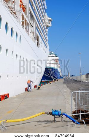 CIVITAVECCHIA ITALY - APRIL 24 2017: Unknown worker doing technical inspection of a large cruise ship in the port of Civitavecchia.