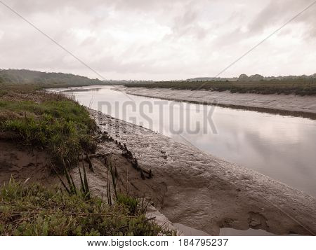 River Running Through Countryside On An Overcast Day