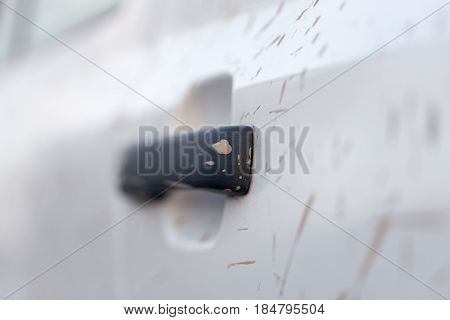 dirt on the white car . A photo