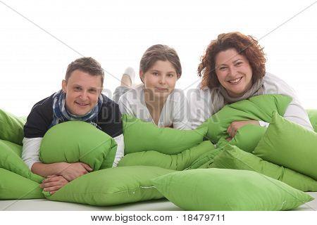 threesome lying on cushions