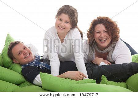 family having fun on cushions