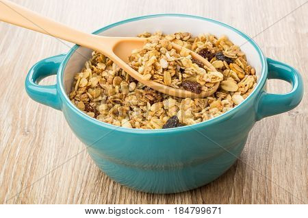 Muesli With Fruits And Nuts And Plastic Spoon In Bowl