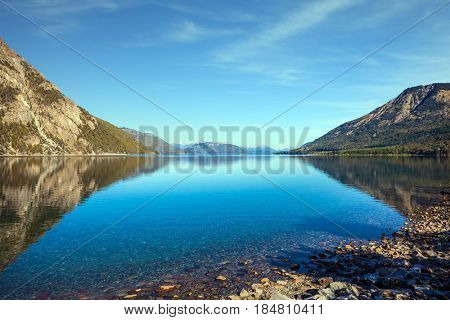 Picturesque mountain and lake in Bariloche, Argentina. The concept of exotic and extreme tourism