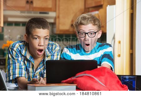 Surprised Students Looking At Computer