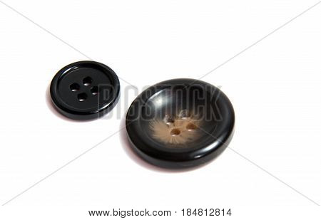 Single brown clothing button isolated over the white background