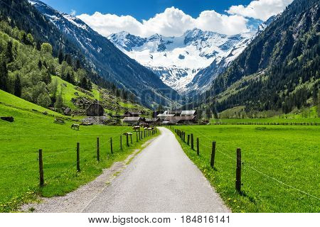 Spring summer mountains landscape with alpine village and snowy peaks in the background. Stillup Austria Tirol