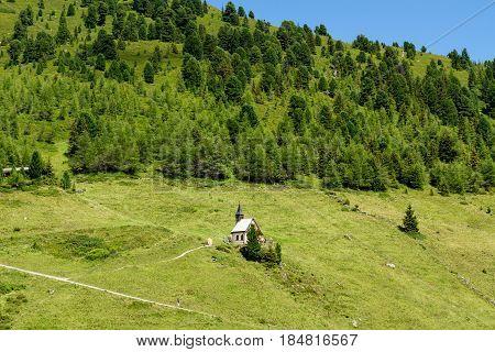 Idyllic mountain scenery with little church in the Alps. Austria Zillertal High Road Tirol