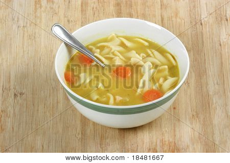 Chicken noodle soup on cutting board