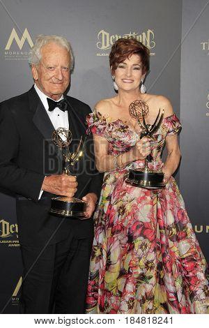 PASADENA - APR 28: Nicholas Coster, Carlyn Hennesy at The 44th Daytime Creative Arts Emmy Awards Gala at the Pasadena Civic Center on April 28, 2017 in Pasadena, California