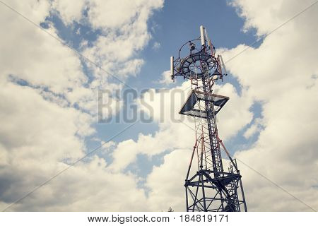 Transmitters And Aerials On Telecommunication Tower During Sunset