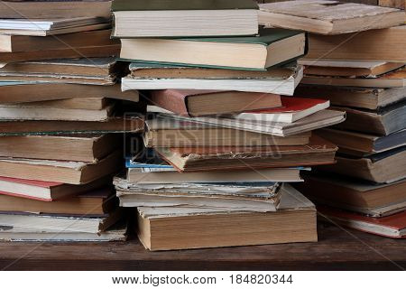 the piles of books on the table. book background.