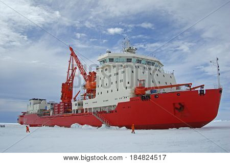 Progress station, Antarctica, January 10, 2017: The cargo ship costs at the floe under unloading. Antarctic.