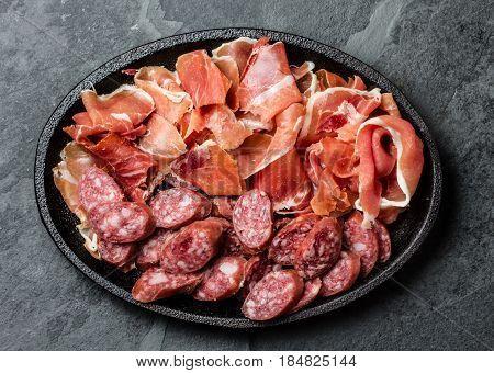Plate of spanish salami and ham jamon serrano