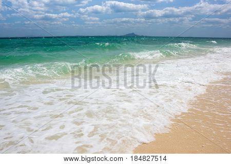 Waves running on the beach of Andaman sea Krabi province Thailand