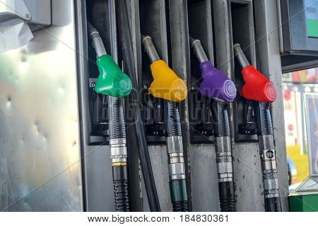Gasoline column for refueling. Four gasoline pump nozzles at petrol station