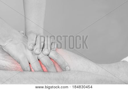 Closeup Of Hands Of Chiropractor/physiotherapist Doing Calf Muscle Massage To Man Patient,  In Silho