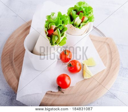 Vegetable wrap sandwiches on a white plate