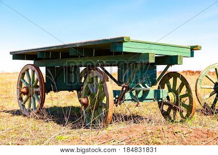 Country life. Old wooden carts without a horses stand at the field