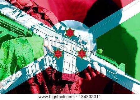 Soldier with machine gun with national flag of Burundi