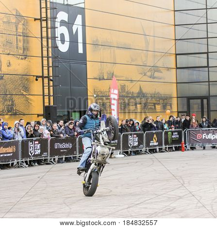 St. Petersburg Russia - 15 April, Biker on the rear wheel,15 April, 2017. International Motor Show IMIS-2017 in Expoforurum. Sports motorcycle show of bikers on the open area.
