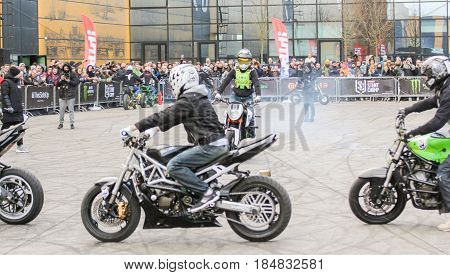 St. Petersburg Russia - 15 April, Bikers are passing in a circle,15 April, 2017. International Motor Show IMIS-2017 in Expoforurum. Sports motorcycle show of bikers on the open area.
