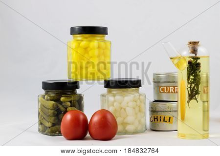 Wonderful vegetable preserves in a kitchen pantry on a white isolated background