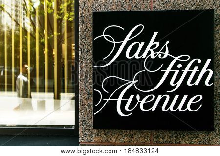 New York April 28 2017: Saks Fifth Avenue sign near the entrance to their store in downtown Manhattan.