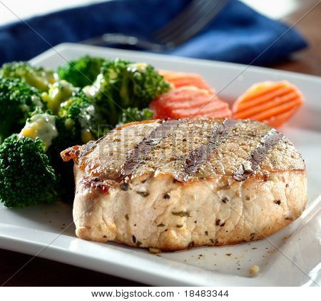 Fine dining meal with pork loin fillet with carrots and broccoli with hollandaise sauce