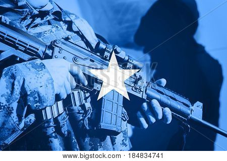Soldier With Machine Gun With National Flag Of Somalia