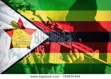 Soldier With Machine Gun With National Flag Of Zimbabwe