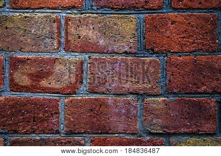 Brick wall of red brick. Old red brick masonry.
