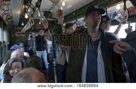 BRONX NEW YORK USA - APRIL 10: Yankee fans ride a vintage Low Voltage train to Yankee Stadium for opening day game. Taken April 10 2017 in New York.