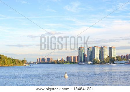 View of Neva river and microdistrict Ribatskoe on the outskirts of St. Petersburg Russia. poster