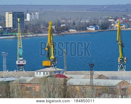The cranes in a cargo port on the seashore