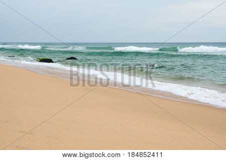 Sand beach Varkala India at overcast day