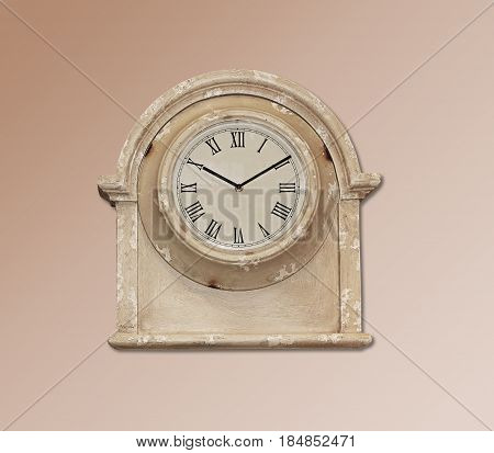 Retro wooden clock hanging on the wall