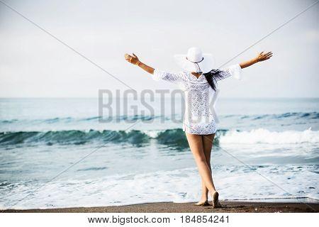 Beautiful girl on the beach. Vacation Resort Lifestyle
