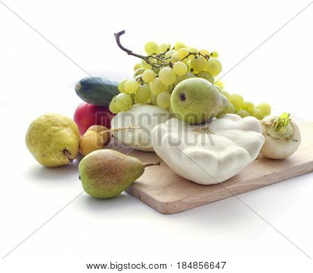 Fresh autumn vegetables ans fruits with cutting board isolated on white