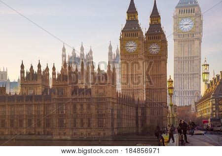 London, UK - November 30, 2016:  Multiple exposure image of beautiful morning on the Westminster bridge with blur of walking people. View include Big Ben and Houses of Parliament.