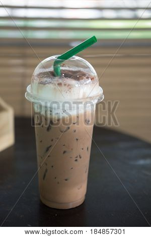 iced cocoa or iced chocolate on wood table