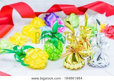 Set ribbon folded into a flower. Wrap coins by hand. for the sacred(ordination matriculation initiation) in Thailand on white background