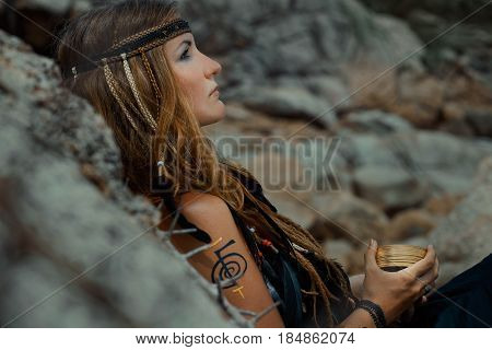 young beautiful woman with tarot cards outdoor