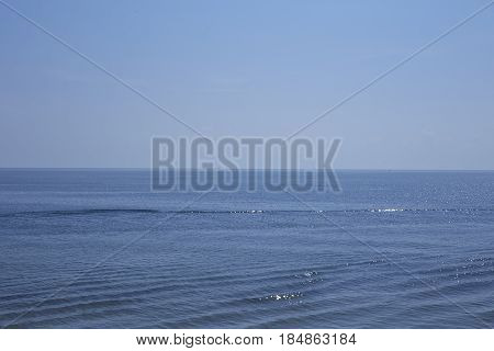 Blue Sea And Blue Sky Background