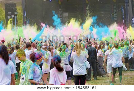 STOCKHOLM SWEDEN - MAY 22 2016: WColor burst at the stage and lots of teenagers covered with color dust in the Color Run Event in Sweden May 22 2016