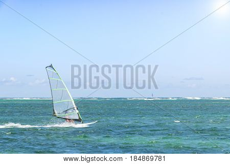 Windsurfing. Windsurfer Surfing The Wind On Waves In Ocean Sea. Extreme Sport Action. Recreational Sporting Activity. Healthy Active Lifestyle