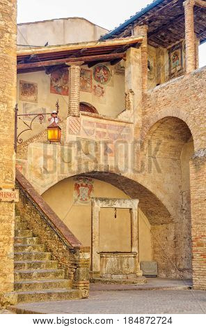 The well, stairway and gallery in the courtyard of  Museo Civico in San Gimignano, Tuscany, Italy - 1 October 2011