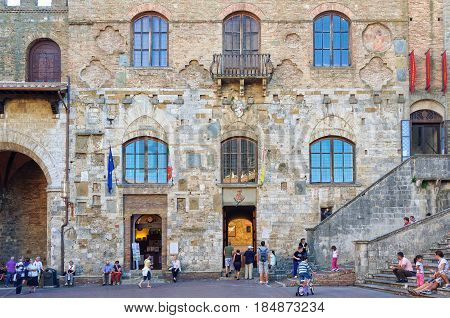 The fascinating facade of Palazzo Nuovo del Podesta on the Piazza del Duomo in San Gimignano, Tuscany, Italy - 1 October 2011