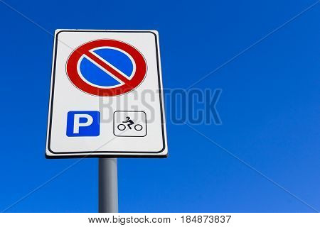 Do not park signage motorcycle parking only. Background blue sky for copy space.
